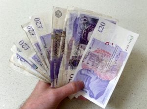 quick payday loans cash sterling in hand like a fan